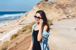 Young beautiful girl looks afar at sea