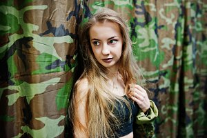 Military girl in camouflage uniform