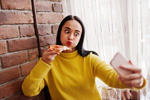 Girl and pizza