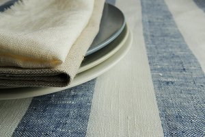 Plate on linen tablecloth