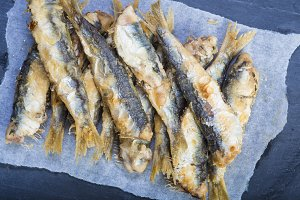 Fried sardines on a slate background