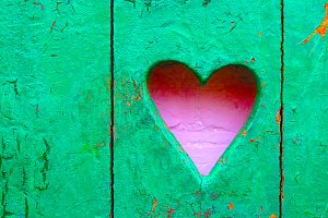 Pink pastel heart on green