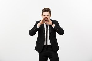 Business Concept: young handsome business man shouting and isolated on white.