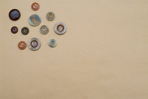 Buttons on craft paper