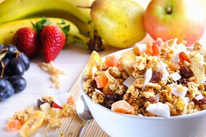 Bowl of cereal and fruits closeup