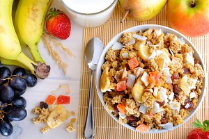 Bowl of cereal and fruits top view