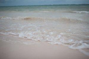 Wave Crashing on Tropical Sand