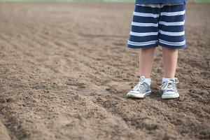 Boy with Sneakers in Dirt