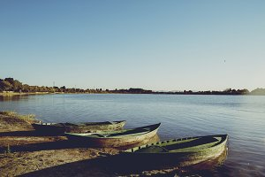 Old wooden boats in the lake shore