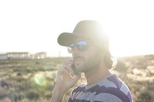 Handsome guy outdoor using phone