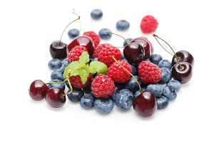blueberry, cherry and raspberry berries isolated on white background