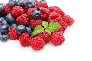 blueberry and raspberry berries isolated on white background