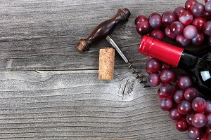 Red Wine and Grapes on Vintage Plank