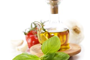 Olive oil, basil and vegetables over