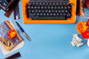 Workspace with vintage orange typewriter