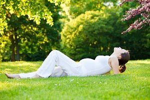 Beautiful pregnant woman in the spring park