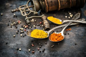 Spices and vintage pepper mill