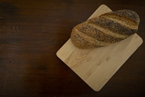Fresh bread on wooden old table