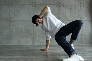 Teen boy doing breakdancing