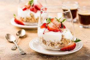 Healthy dessert with granola and berries