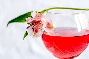 A flower on a wine glass