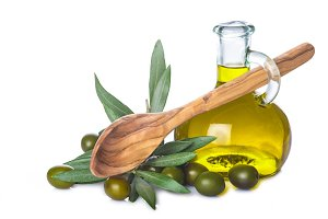 Olive oil bottle and wooden spoon isolated