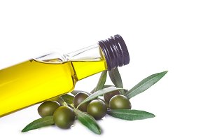 Olive oil bottle with leaves isolated on white background