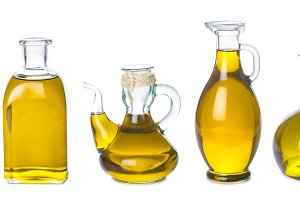 Set of olive oil jars isolated on a white background