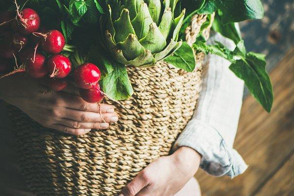 Farmer in apron holding basket