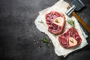 Raw beef steak osso bucco on black. Marble meat.