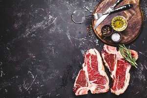 Two raw marbled meat steaks T-bone