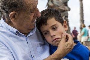 Grandfather comforting his grandson