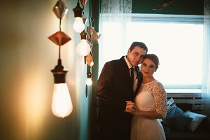 couple groom and bride in light studio