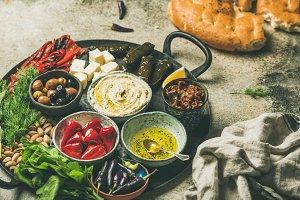 Mediterranean meze starter fingerfood platter in tray, selective focus