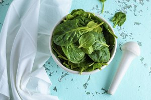 raw green spinach leaves