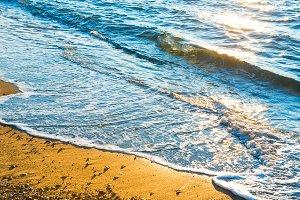 Sea surf on the sunny beach