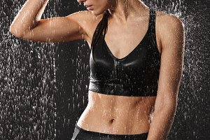 Portrait of a fit young sportswoman holding water bottle