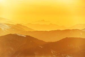 Beautiful orange sunset in mountains