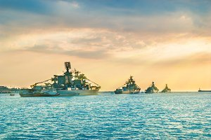 Military navy ships at sunset