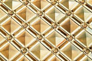Symmetric golden pattern texture background