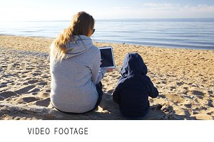 Mother and son on the beach with