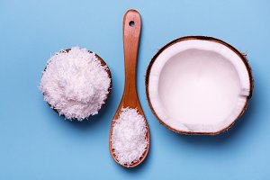 coconut flakes, spoon and half of coconut