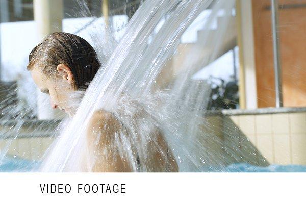 Woman enjoying strong water shower