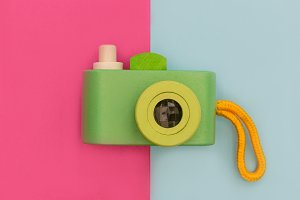 Cute retro camera green on pink