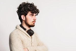Portrait of a young man with headphones in a studio. Copy space.