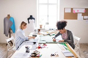 Young creative women in a studio, startup business.
