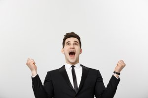 Business Concept: Excited handsome businessman celebration success. Isolated on white