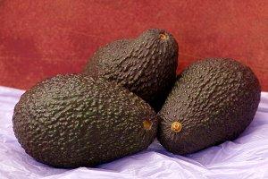 Ripe avocado on dark abstract