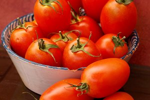 Red tomatoes in a old tray