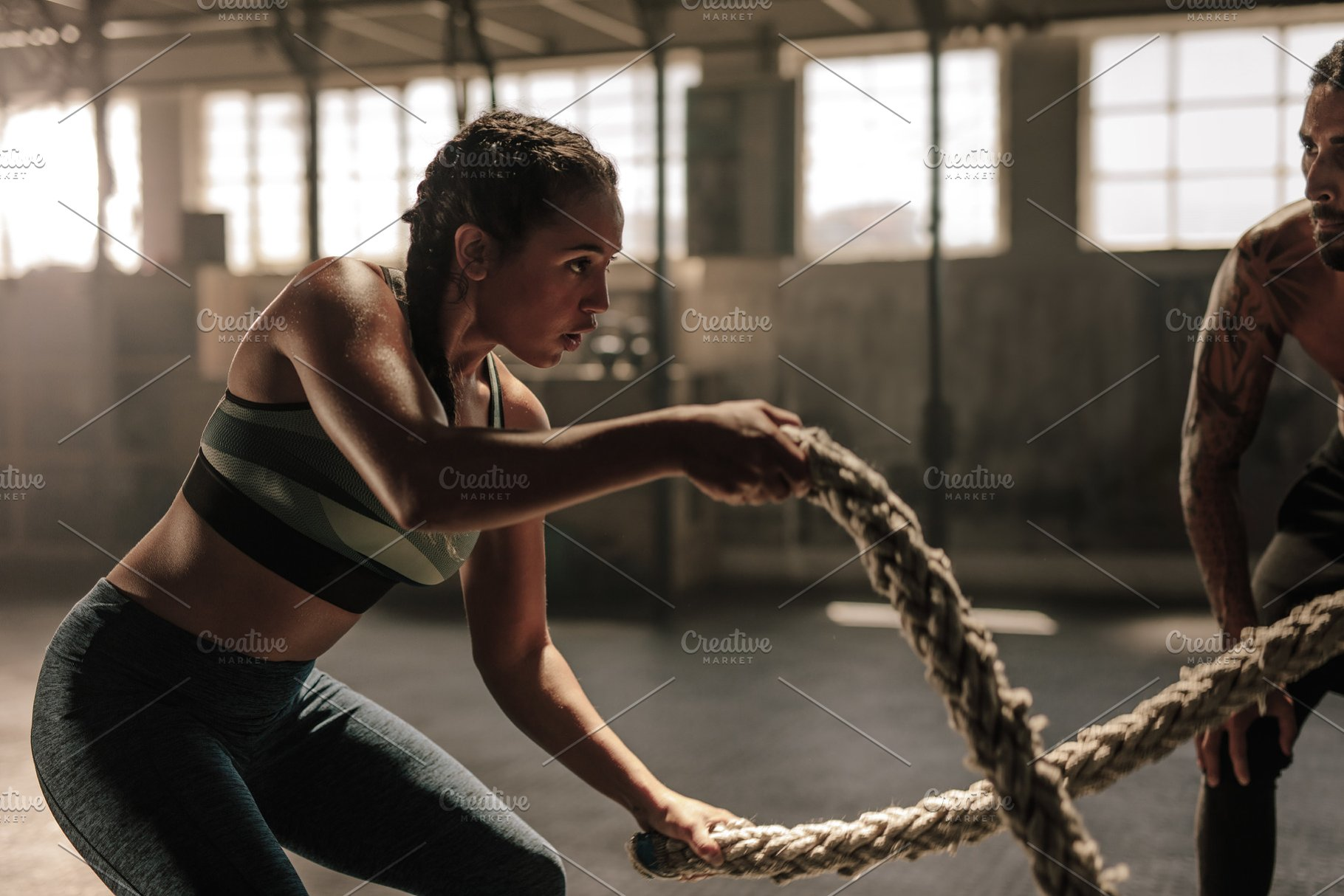 Woman doing battle rope workout